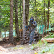 Stock Photo: Paintball player walking away