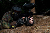 Paintball player Lying Down — Stock Photo