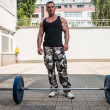 Man Resting After Doing Lunge with Barbells — Stock Photo