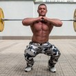 Bodybuilder Doing Front Squats With Barbells — Stock Photo