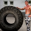 Muscular Man Resting After Tire Workout — Stock Photo