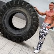 Bodybuilder Resting After Turning Tires — Stock Photo #32176463