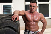 Bodybuilder Resting After Turning Tires — Stock Photo
