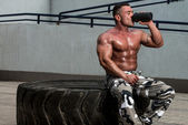 Bodybuilder Drinking — Stock Photo