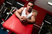 Man relaxing after exercise with weights — Stock Photo