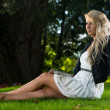 Pretty Woman Sitting On The Grass With Digital Tablet — Stock Photo