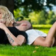 Couple In Love Laying Down In The Grass — Stock Photo