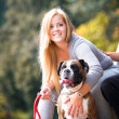 Couple Sitting Outdoors With Her Pet Dog German Boxer — Stock Photo #33842665