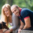 Happy Couple With German Boxer — Stock Photo #33843443