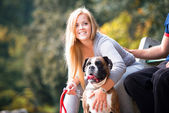Couple Sitting Outdoors With Her Pet Dog German Boxer — Stockfoto