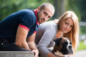 Young Couple With Dog — Stock Photo