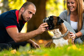 Couple Sitting Outdoors With Her Pet Dog German Boxer — Stock Photo