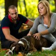 Happy Couple With German Boxer — Stock Photo #33850299