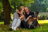 Happy Couple With German Boxer — Stock Photo