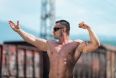 Body Builder Posing At The Railroad — Stock Photo