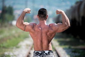 Man Showing His Back Double Biceps — Stock Photo
