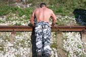 Muscular Man Doing Push-ups — Stock Photo