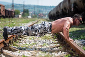 Man Doing Pushups On Railroad — Stock Photo