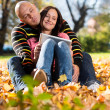 Happy Young Couple In Autumn Park — 图库照片