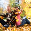 Couple Listening To Music And Throwing Leaves — Stock Photo
