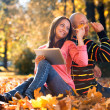 Couple With Headphones Enjoying Music In Autumn — Stock Photo