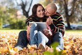 Happy Young Couple With Tablet Computer In The Park — Stock Photo