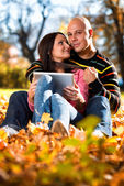 Happy Caucasian Couple With A Digital Tablet — Stock Photo