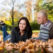 Couple Sitting Together In The Woods During Autumn — Stock Photo #35143259