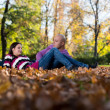Happy Couple Sitting Together In The Woods During Autumn — Stock Photo
