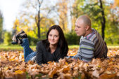Couple Sitting Together In The Woods During Autumn — Stock Photo