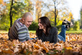 Couple Lying Together At The Park — Stock Photo