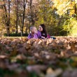 Couple Sitting Together In The Woods Outside During Autumn — Stock fotografie