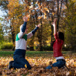 Couple Having Fun With Autumn Leaves In Garden — Stock Photo