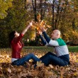 Couple Having Fun With Autumn Leaves In Garden — Stock Photo #35156579