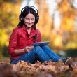 Girl Listening Music In The Autumn Sunshine — Stock Photo