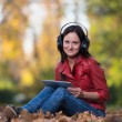 Young Girl With Headphones Enjoying Music In Autumn — Foto de Stock