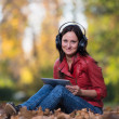 Young Girl With Headphones Enjoying Music In Autumn — Stockfoto