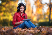 Girl Listening Music In The Autumn Sunshine — Stok fotoğraf