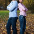 Happy Young Couple With Arms Crossed — Stock Photo