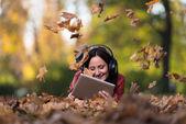 Smiling Female Listening To Music Autumn — Stok fotoğraf