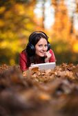 Girl Listening Music In The Autumn Sunshine — Photo