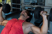 Man Doing Incline Chest Presses With Dumbbells In Gymnasium — Stock Photo