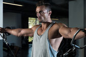 Bodybuilder Doing Exercise For Shoulder — Stock Photo