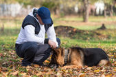 Man Playing With Dog German Shepherd In Park — Stock Photo