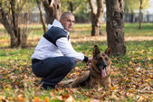 Man Holding Dog German Shepherd — Stock Photo