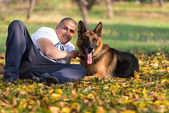 Man Holding Dog German Shepherd — Stock Photo
