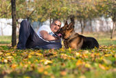 Adult Man Sitting Outdoors With His German Shepherd — Stock Photo