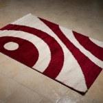 Single Red Carpet Folded On Floor — Stock Photo