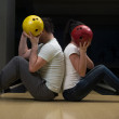 Young Couple Hiding Their Faces Behind Bowling Ball — Stock Photo #38820667