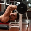 Man In The Gym Exercising Triceps With Barbell — Stock Photo